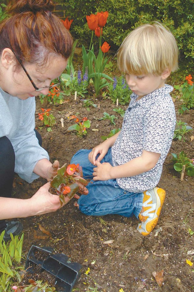Preschooler learns about planting